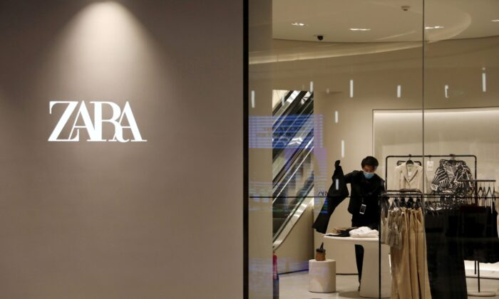 A staff member sorts clothes inside a clothing store of Inditex's Zara brand at a newly opened shopping mall in Beijing, China on April 16, 2021. (Tingshu Wang/Reuters)
