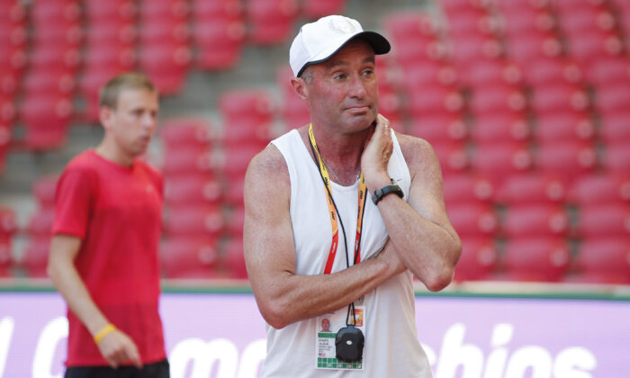 Coach Alberto Salazar stands in front of Galen Rupp of the USA at the World Athletics Championships in Beijing on Aug. 21, 2015. (Phil Noble/Reuters)