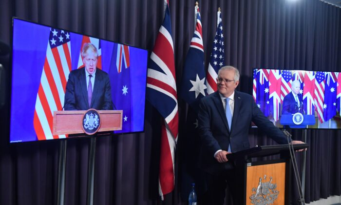 Britain's Prime Minister Boris Johnson, Australia's Prime Minister Scott Morrison, and U.S. President Joe Biden at a joint press conference via AVL from The Blue Room at Parliament, in Canberra, Australia, on Sept. 16, 2021. (Mick Tsikas/AAP Image)