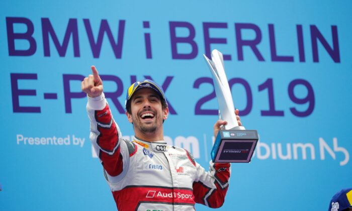 Audi Sport Abt Schaeffler's Lucas Di Grassi celebrates winning a race with the trophy in Berlin on May 25, 2019. (File photo via Reuters)