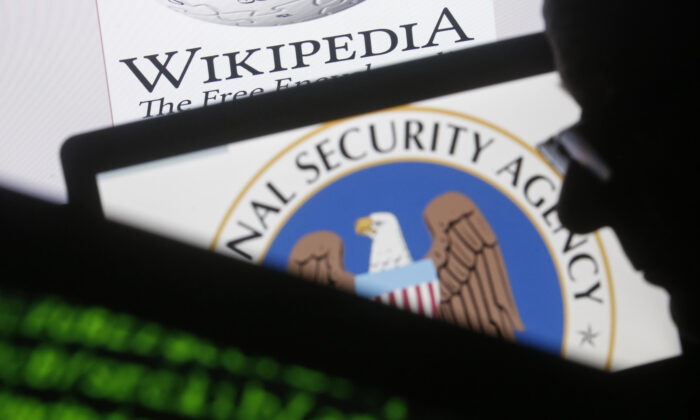 A man is seen near cyber code and the U.S. National Security Agency logo in this photo illustration taken in Sarajevo March 11, 2015. (Dado Ruvic/Reuters, Files)