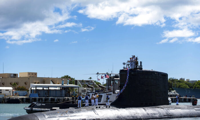The Virginia-class nuclear-powered attack submarine USS Illinois (SSN 786) returns home to Joint Base Pearl Harbor-Hickam from a deployment in the 7th Fleet area of responsibility on Sept. 13, 2021. (Mass Communication Specialist 1st Class Michael B. Zingaro/U.S. Navy via AP)
