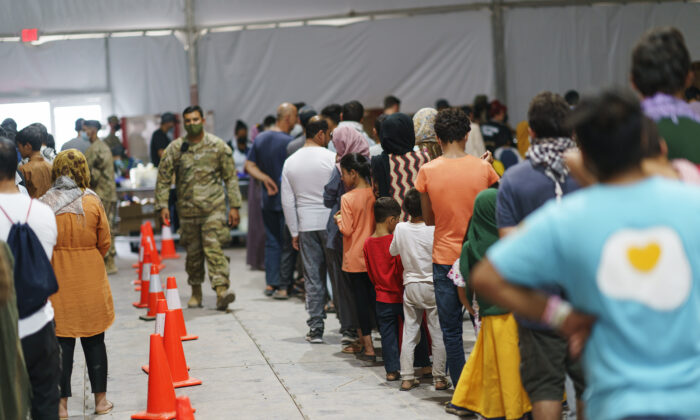 Afghan refugees line up for food in a dining hall at Fort Bliss' Doña Ana Village, New Mexico on Sept. 10, 2021. (David Goldman/AP Photo)