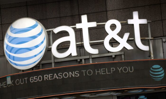 The AT&T logo is positioned above one of its retail stores, in New York on Oct. 24, 2016. (Mark Lennihan/AP Photo)