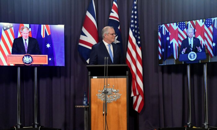Australia's Prime Minister Scott Morrison appears on stage with video links to Britain's Prime Minister Boris Johnson (L) and U.S. President Joe Biden at a joint press conference at Parliament House in Canberra on Sept. 16, 2021. (Mick Tsikas/AAP Image via AP)