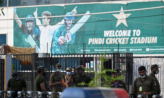 Policemen stand guard outside the Rawalpindi Cricket Stadium in Rawalpindi, Pakistan, on Sept. 17, 2021. (Aamir Qureshi/AFP via Getty Images)