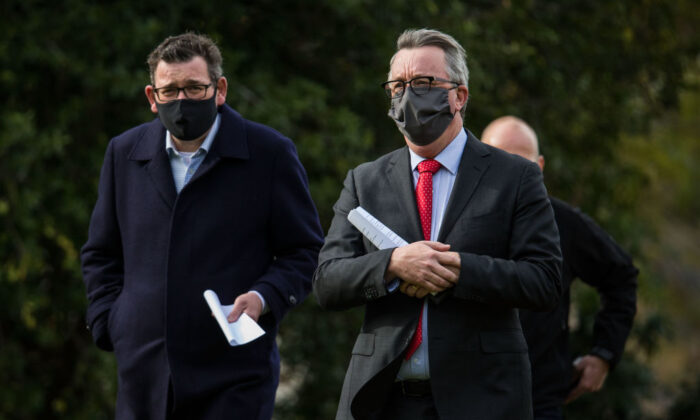 Victorian Premier, Daniel Andrews, Health Minister, Martin Foley and Victorian COVID-19 Testing Commander, Jeroen Weimar arrive at the daily press conference  on July 27, 2021 in Melbourne, Australia. (Darrian Traynor/Getty Images)