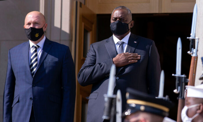 U.S. Secretary of Defense Lloyd Austin (R) and Australian Minister for Defense Peter Dutton stand for their national anthems during an honor cordon at the Pentagon in Arlington, Virginia, on Sept. 15, 2021 (Kevin Dietsch/Getty Images)