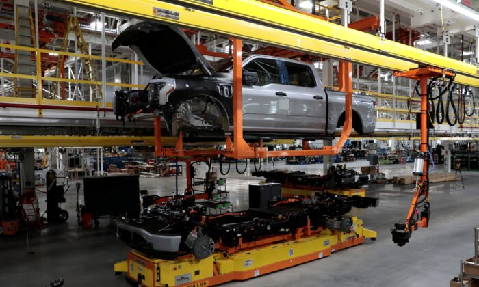 Parts of a Ford pre-production all-electric F-150 Lightning truck prototype are seen at the Rouge Electric Vehicle Center  in Dearborn, Mich., on Sept. 16, 2021. (Rebecca Cook/Reuters)