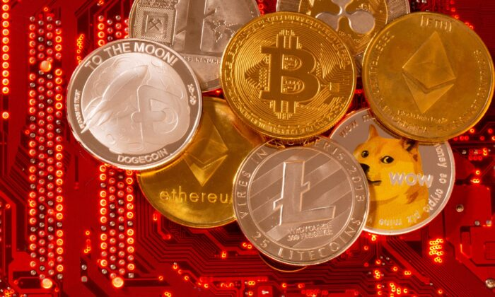 Representations of cryptocurrencies Bitcoin, Ethereum, Dogecoin, Ripple, Litecoin are placed on PC motherboard in this illustration taken on June 29, 2021. (Dado Ruvic/Illustration/Reuters)