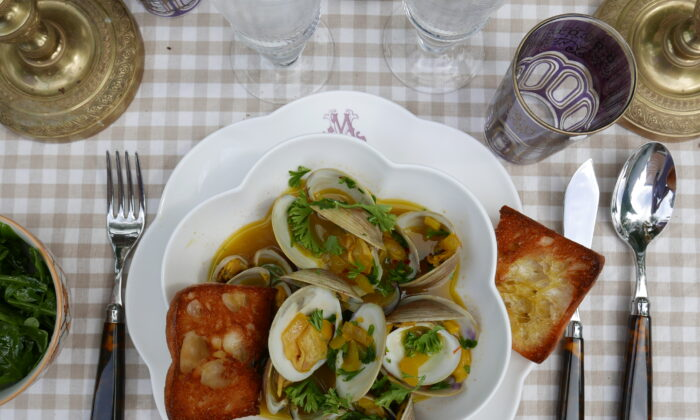 Serve these clams with plenty of garlic bread for dipping in the briny, saffron-infused sauce. (Victoria de la Maza)