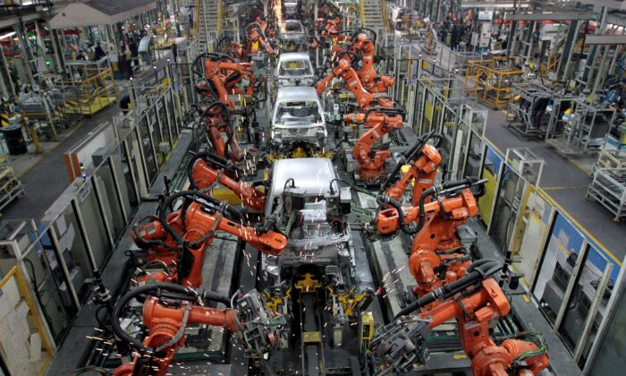 Ford cars are assembled at a plant of Ford India in Chengalpattu, on the outskirts of Chennai, India on March 5, 2012. (Babu/Reuters)