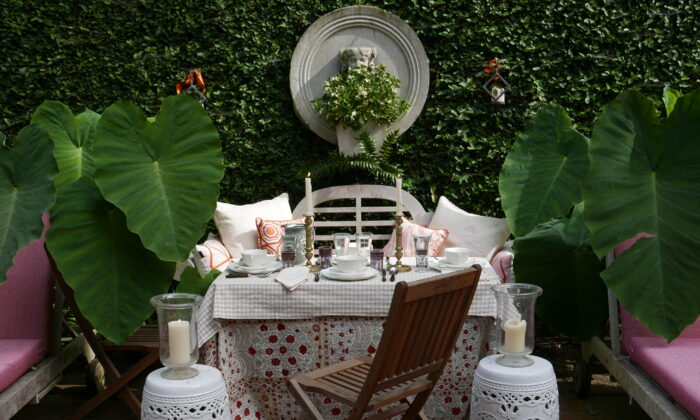 Set the scene with comfy pillows, greenery, and glowing candlelight for when the sun goes down. (Victoria de la Maza)