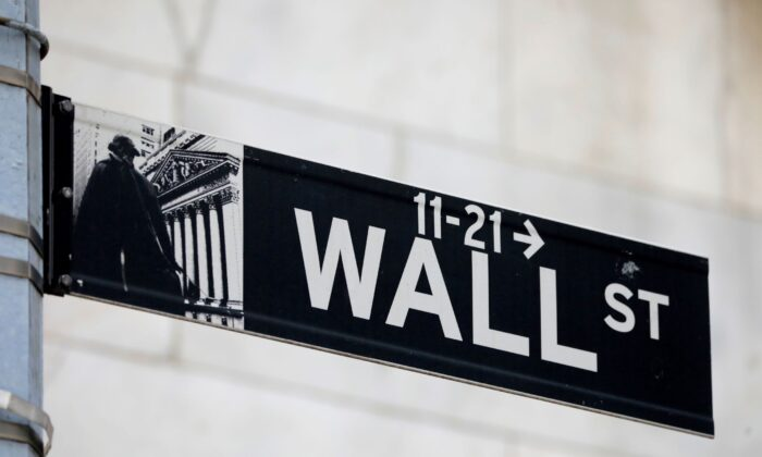 A street sign for Wall Street is seen outside of the New York Stock Exchange (NYSE) in New York City, N.Y., on June 28, 2021. (Andrew Kelly/Reuters)