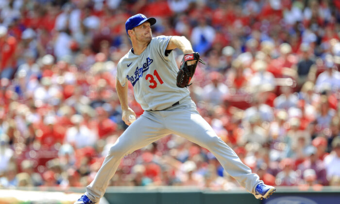 Los Angeles Dodgers' Max Scherzer throws during the first inning of a baseball game against the Cincinnati Reds in Cincinnati on Sept. 18, 2021. (AP Photo/Aaron Doster)
