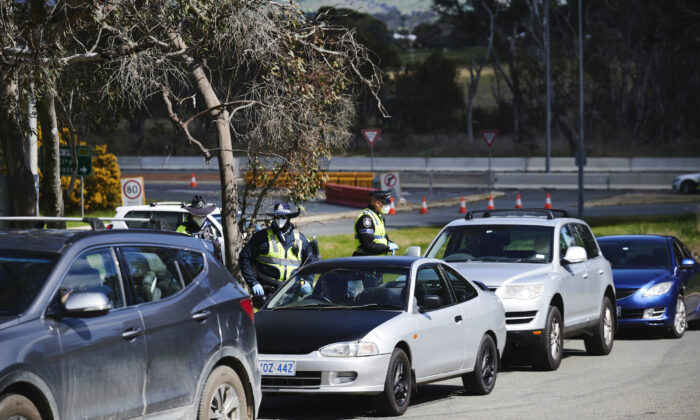 ACT Police perform checks on traffic on the NSW/ACT Border in Australia, on Sept. 14, 2021. (Rohan Thomson/Getty Images)