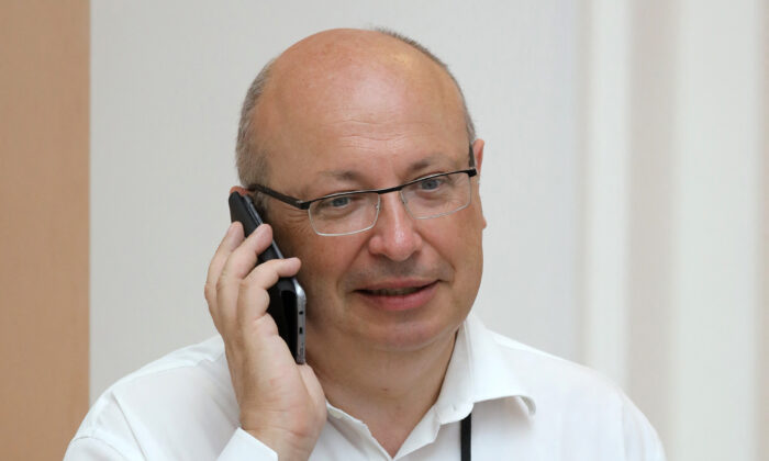 Jean-Pierre Thebault, then French ambassador in charge of G7 summit preparations, speaks on his mobile phone while working in Biarritz, south-west France, on Aug. 25, 2019. (Ludovic Marin/AFP via Getty Images)
