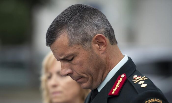 Maj.-Gen. Dany Fortin speaks to reporters outside the Gatineau Police Station after being processed, in Gatineau, Que., on Aug. 18, 2021. (The Canadian Press/Justin Tang)