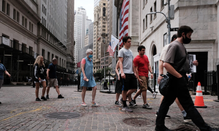 People walk by the New York Stock Exchange (NYSE) on August 10, 2021, in New York. (Spencer Platt/Getty Images)