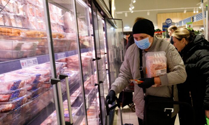 People shop in the meat aisle in a Lidl supermarket in Walthamstow, east London, on March 20, 2020. (Tolga Akmen/AFP via Getty Images)
