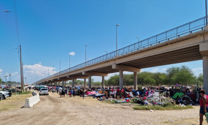 Illegal immigrants sheltering under the Del Rio International Bridge that connects with Ciudad Acuna in Mexico are seen in the border community of Del Rio, Texas, on Sept. 18, 2021. (Handout via Reuters)
