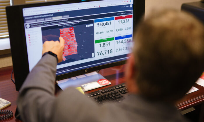Dr. Scott Harris, Alabama's state health officer, points at a computer screen in his office in Montgomery, Ala., on June 29, 2021. (Elijah Nouvelage/AFP via Getty Images)