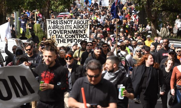Protesters march through the streets during a rally against government COVID-19 restrictions in Melbourne on Sept. 18, 2021. (William West/AFP via Getty Images)