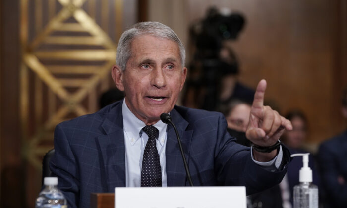 Top infectious disease expert Dr. Anthony Fauci responds to accusations by Sen. Rand Paul (R-Ky.), as he testifies before the Senate Health, Education, Labor, and Pensions Committee on Capitol Hill on July 20, 2021. (J. Scott Applewhite/Pool/AP Photo)
