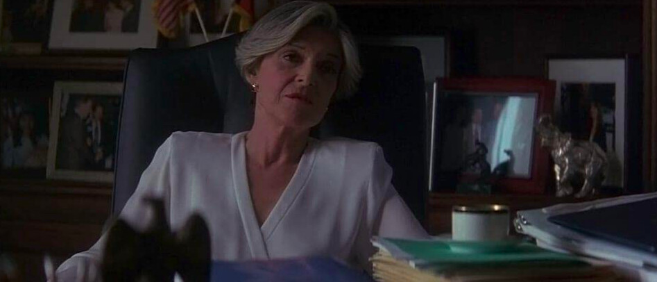 woman in white blouse at desk in G.I. Jane
