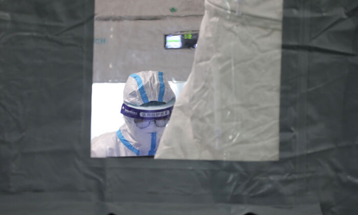A laboratory technician wearing personal protective equipment shows at a temporary COVID-19 testing facility in Xiamen, Fujian Province, China, another hotspot of the latest outbreak on  Sept. 16, 2021. (STR/AFP via Getty Images)