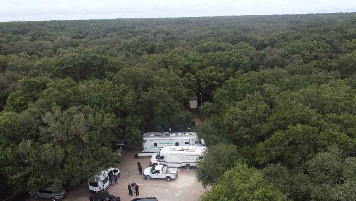 Law enforcement officials conduct a search