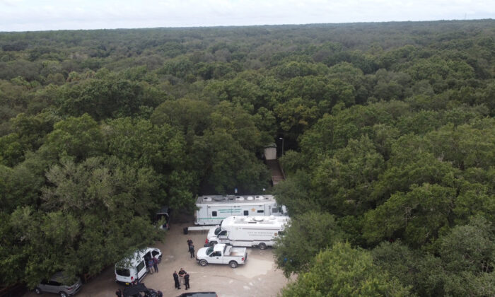 Law enforcement officials conduct a search for Brian Laundrie in the Carlton Reserve in Sarasota, Fla., on Sept. 18, 2021. (North Port Police Department via AP)