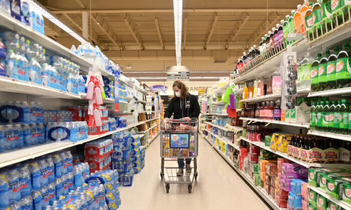 Professional shopper shops for a customer at Acme Market in Clark, New Jersey, on April 27, 2020. (Michael Loccisano/Getty Images)