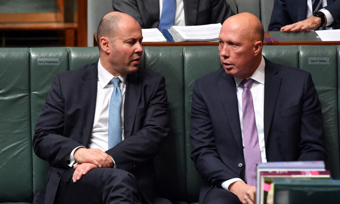 Australian Treasurer Josh Frydenberg speaks to Minister for Defence Peter Dutton during Question Time in the House of Representatives at Parliament House in Canberra, Australia, on June 22, 2021. (Sam Mooy/Getty Images)