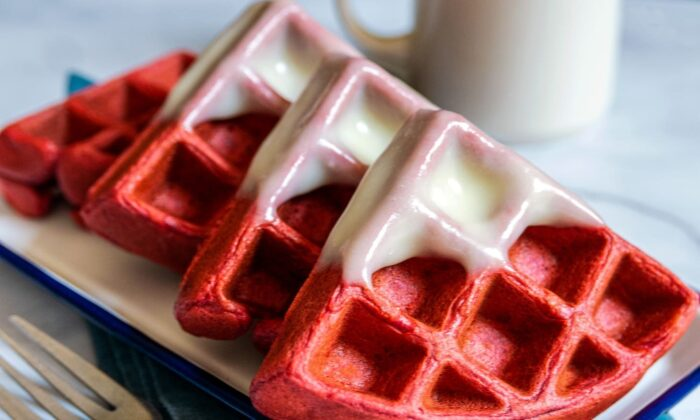 The tangy cream cheese glaze perfectly complements the sweet waffles—drizzle it on top, or dunk the waffles in like donuts. (Perry Santanachote/TNS)