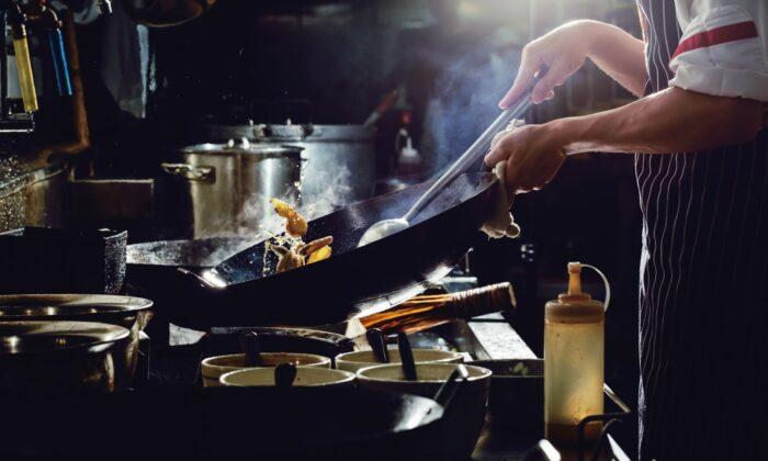 Start with a heavy wok and high heat. (U2M Brand/shutterstock)
