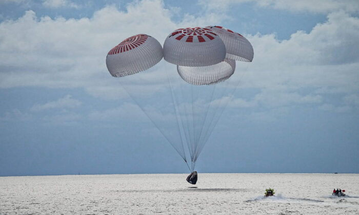 The quartet of newly minted citizen astronauts comprising the SpaceX Inspiration4 mission safely splashes down in SpaceX's Crew Dragon capsule off the coast of Kennedy Space Center, Florida, on Sept, 18, 2021. (SpaceX/Handout via Reuters)