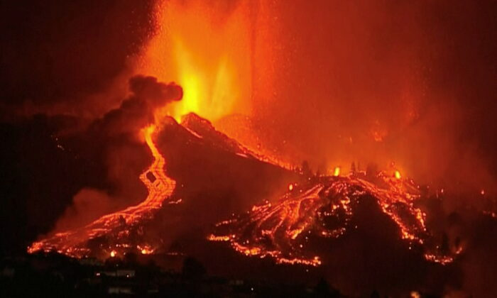 Lava pours out of a volcano in the Cumbre Vieja national park at El Paso, on the Canary Island of La Palma, on Sept. 19, 2021. (FORTA/Screenshot via Reuters)