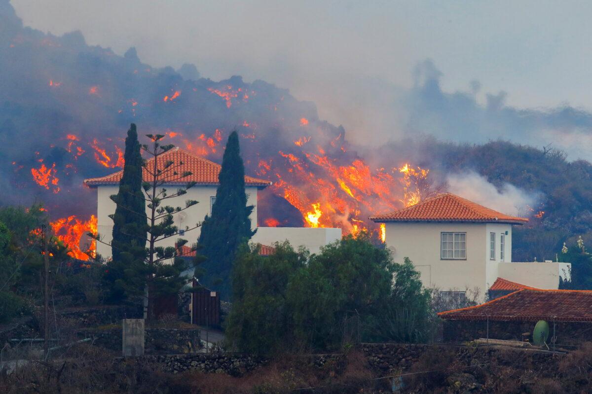 Lava flows behind a house