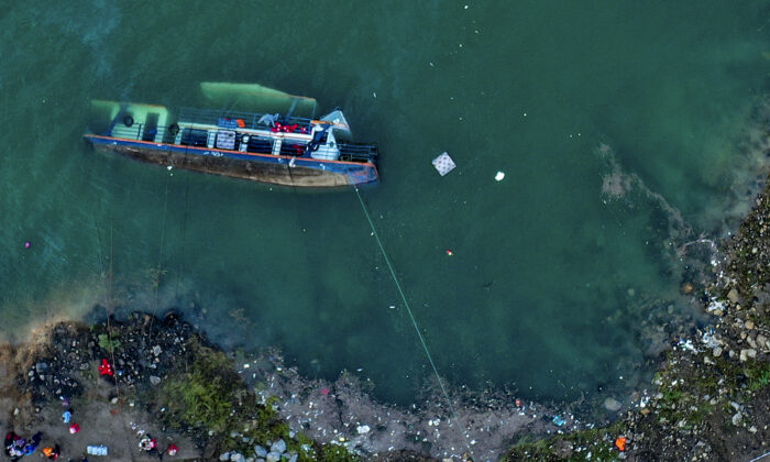 The site of an overturned passenger ship in Liupanshui in southwest China's Guizhou Province on Sept. 19, 2021. (Ou Dongqu/Xinhua via AP)