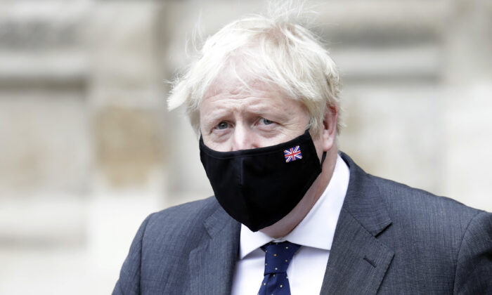 British Prime Minister Boris Johnson departs the Battle of Britain 81st Anniversary Service of Thanksgiving and Rededication at Westminster Abbey in London on Sept. 19, 2021.  (John Phillips/Getty Images)