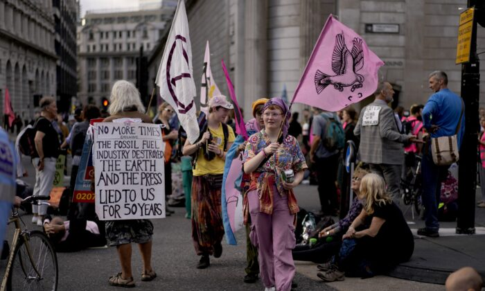 Extinction Rebellion climate change activists take part in a protest outside the Bank of England in London on Sept. 2, 2021. (AP Photo/Matt Dunham)