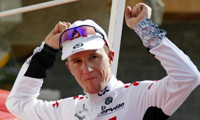 Chris Anker Sorensen of Denmark celebrates on the podium after winning the sixth stage of the Dauphine cycling race between Morzine and La Toussuire, in La Toussuire, French Alps, on June 14, 2008. (Robert Pratta/Reuters)