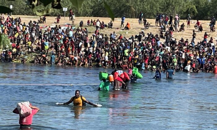 Illegal immigrants cross the Rio Grande River from Del Rio, Texas to Acuna, Mexico, as seen from Acuna, on Sept. 20, 2021. (Charlotte Cuthbertson/The Epoch Times)