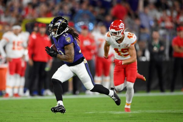 Baltimore Ravens running back Devonta Freeman (L)
