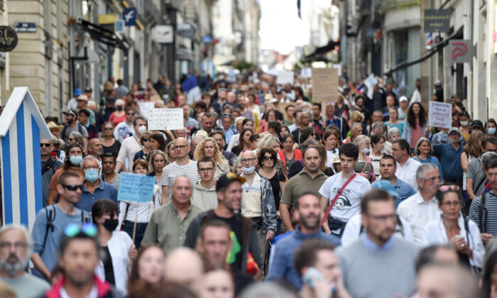 Demonstrators hold placards and chant slogans as they march during a rally in Nantes, western France, on Sept. 18, 2021. (Sebastien Salom-gomis/AFP via Getty Images)