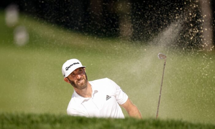 Dustin Johnson plays his shot in a championship golf tournament in Owings Mills, Md., on Aug. 26, 2021. (Scott Taetsch/USA TODAY Sports via Reuters)