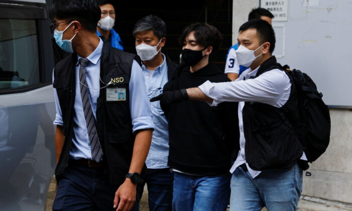 Convenor of Student Politicism Wong Yat-chin is detained by police, in Hong Kong, on Sept. 20, 2021. (Tyrone Siu/Reuters)