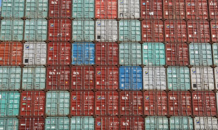 Containers are piled up at Port Botany facilities in Sydney Australia on Feb. 6, 2018. (Daniel Munoz/Reuters)