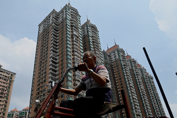 A man drives past a housing complex by Chinese property developer Evergrande in Guangzhou, China's southern Guangdong Province, on Sept. 17, 2021. (Noel Celis/AFP via Getty Images)